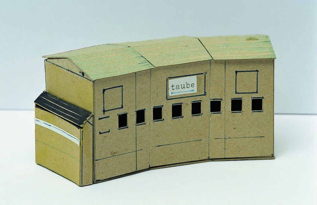 This photograph shows the model of a building with the inscription:
