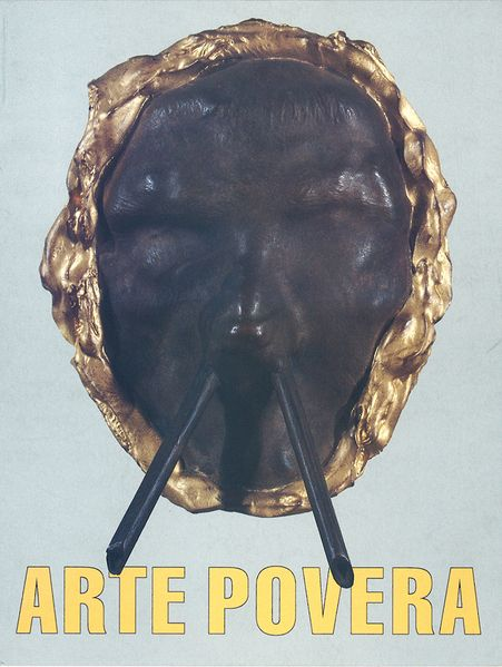 This view includes a flyer card for the Arte Povera exhibition in Gothenburg. At the bottom are the words Arte Povera in yellow letters. Above it is a sculpture with features of a face and a golden, irregular rim. Two sticks seem to come out of the
